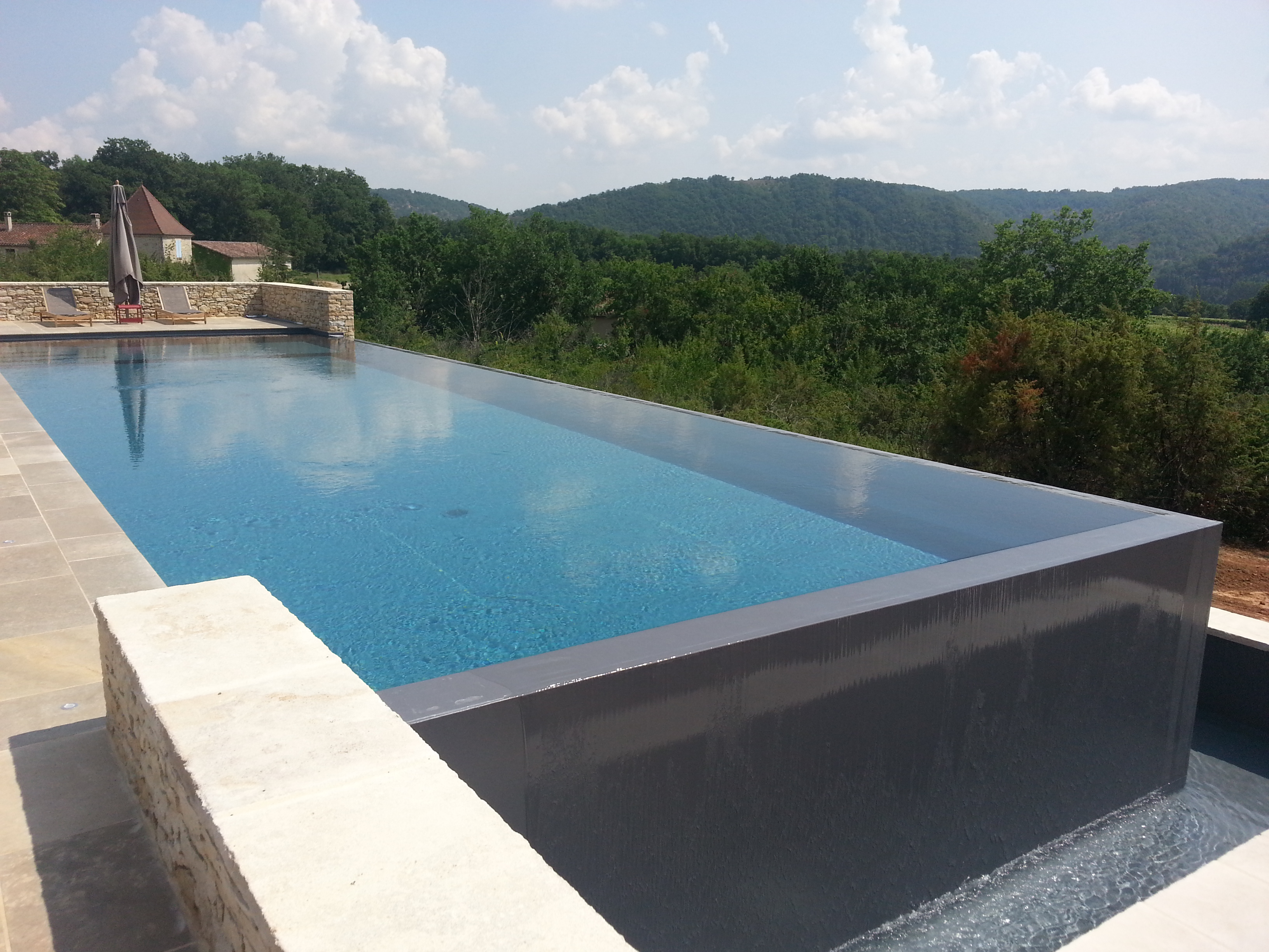 Constructeur de piscine d bordement en haute garonne for Construction piscine everblue